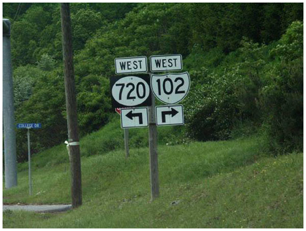 Confusing road sign showing both directions as being 'west'.